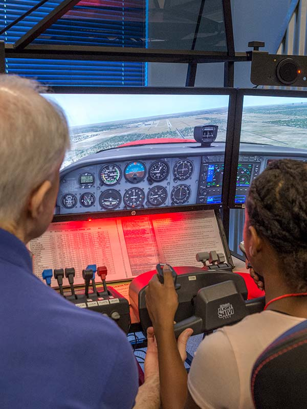student on flight simulator